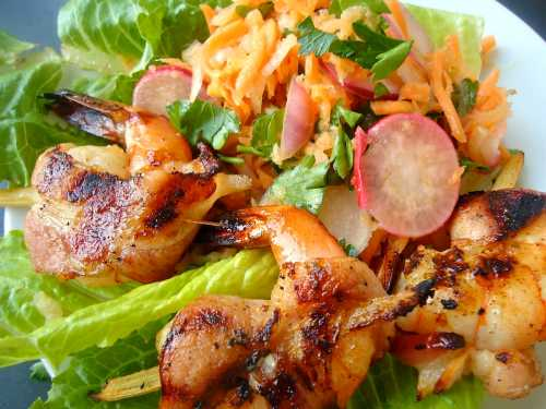 Here is this slaw served with grilled sugar cane shrimp (wrapped in bacon).