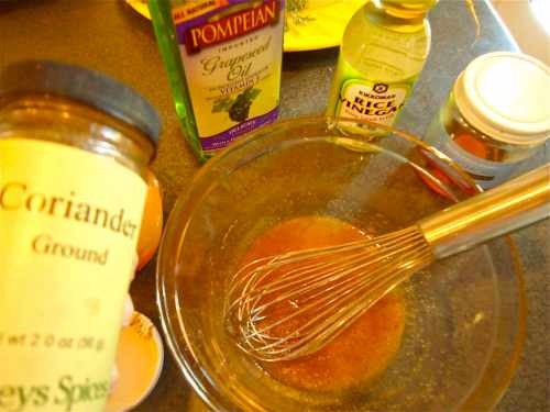 Mix up the tangy dressing. The ground coriander adds a nice light lemon flavor.