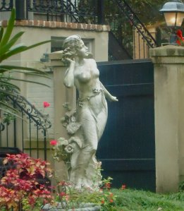 "There's a pretty lady in this side garden, 'peek"" gardens are similar to those found in Charleston, SC."