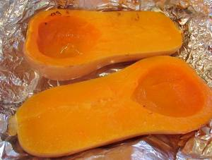 After roasting the squash, open the foil and allow to cool enough to handle.