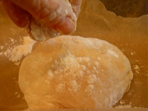 Here the dough is mixed  and kneaded (either by the mixer or by hand). Use a little extra flour as it will be somewhat sticky to the touch. Wrap it in plastic and allow to rest in the frig.