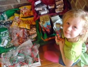 A girl and her candy are not soon parted at Wright Square Cafe.
