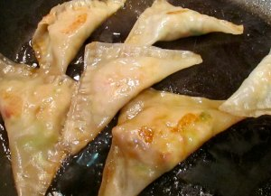 Cover the pot stickers and allow to steam a bit, then uncover and they're ready!