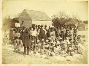 The newly freed slaves and one of their Union liberators on Hilton Head Island. These Gullah ancestors became the first Freemen of Mitchelville.