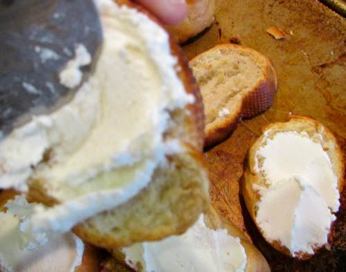 Put the toasts together - slather a good layer of the goat cheese on toasted French bread slices, top with the warm mushroom mixture and sprinkle with parsley.