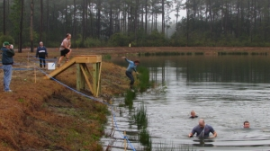 The last obstacle was a jump into one of the lagoons. At least most of the mud gets washed off...