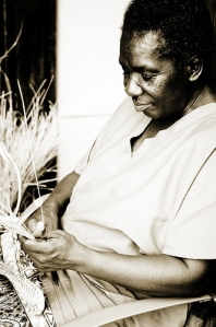Gullah artisan creating a one-of-a-kind sweetgrass basket.