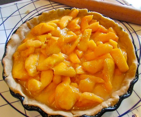 Pour the peaches into the pie shell and ...
