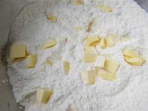 Begin the 'cake' by cutting the butter into the dry ingredients.