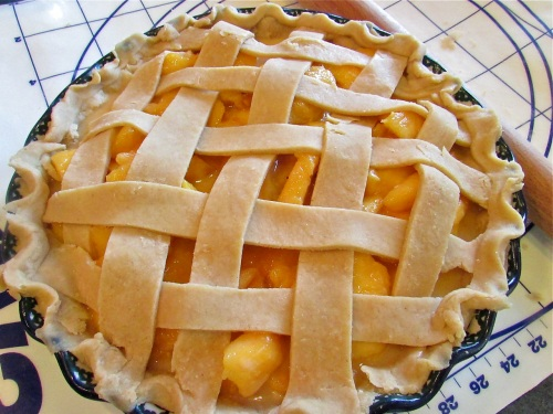 Add the top pie crust . I like a lattice crust peach pies - so pretty and allows me to better gauge when the pie is ready to come out of the oven.